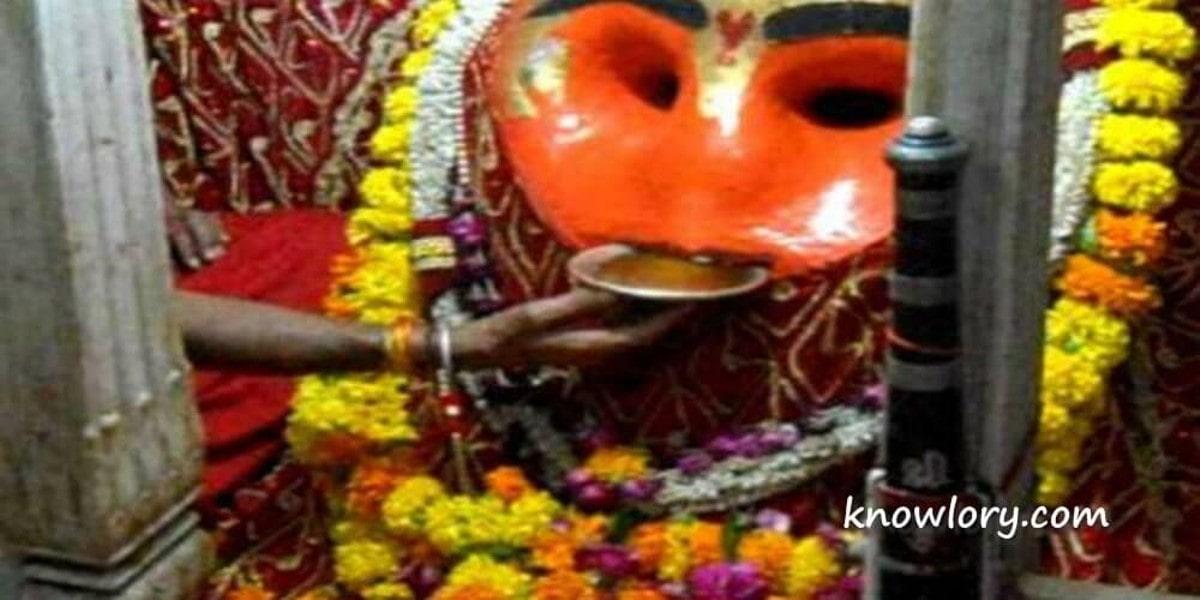 Shri Kaal Bhairav Hindu Deity Drinks Liquor